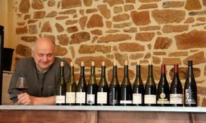 jean-paul brun with bottles of beaujolais